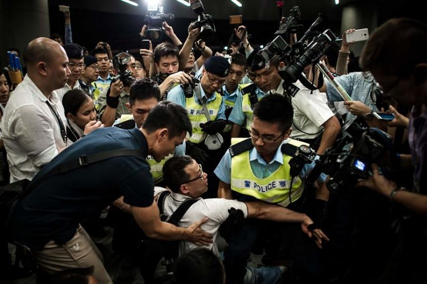 File photo showing policemen removing activists from the grounds of the Legislative Council in Hong Kong during the 2014 protest.
