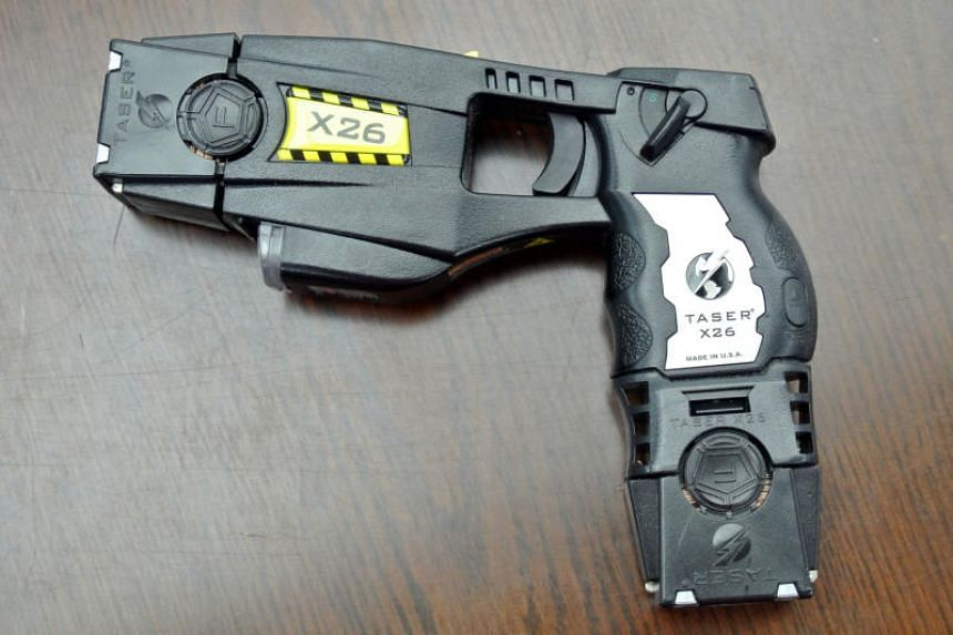 A Taser is a brand of electronic stun gun that fires probes that stick in a person's skin and transmit 50,000 volts of electricity, along with a painful, paralysing shock.