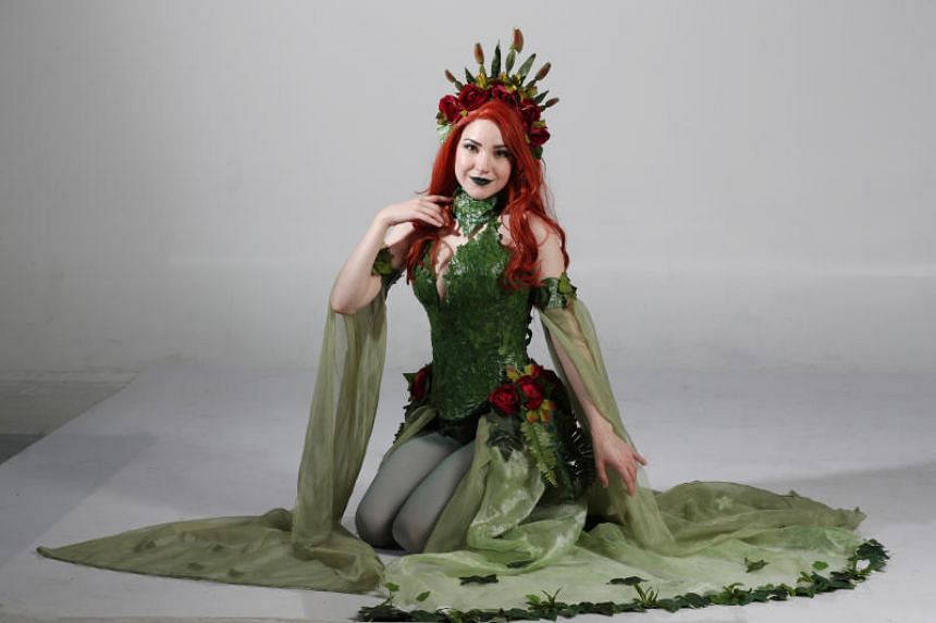 American costume designer and cosplayer Olivia Mears donning a Poison Ivy outfit she created.