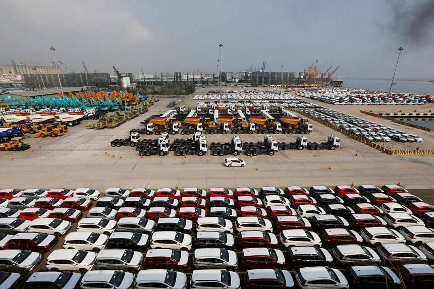 New cars wait to be loaded onto cargo ships for export at the Tanjung Priok Car Terminal in Jakarta, Indonesia.