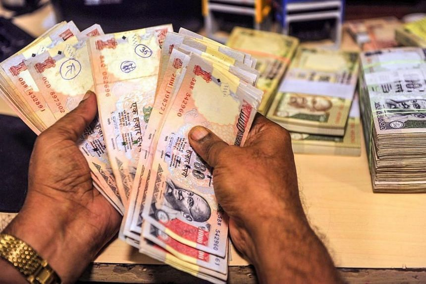 Concerns over India's trade deficit and inflation caused by high oil and commodity prices continued to weigh on the rupee, which hit new lows.