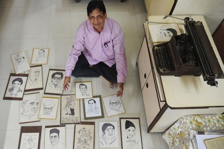 Indian artist Chandrakant Bhide poses with artwork showing various portraits of public figures and deities which he created using a typewriter. From politicians and film stars to cricketers, animation characters and religious symbols, Mr Bhide has pr