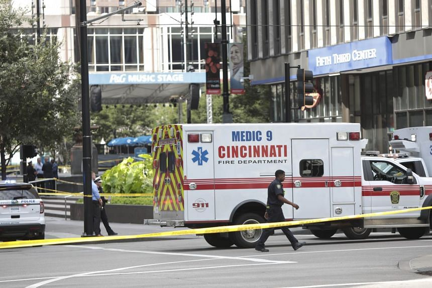 Police and fire officials investigate following a shooting in Cincinnati, Ohio.