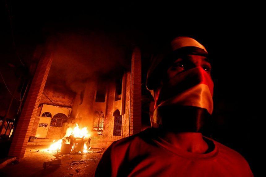 Iraqi protesters burn the Iranian Consulate in Basra, Iraq.