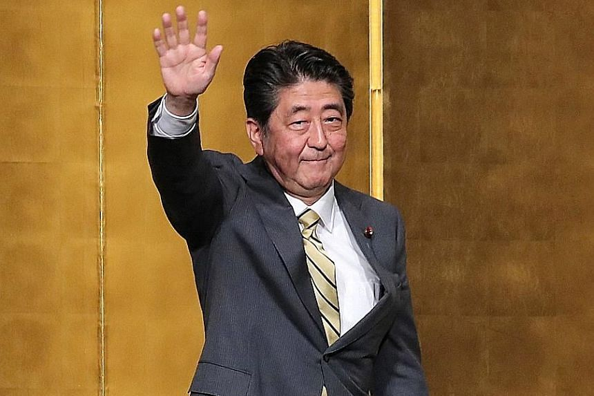 Japanese Prime Minister Shinzo Abe (left) and former defence minister Shigeru Ishiba are vying for the top LDP post. But Mr Abe is widely expected to win the contest, having secured the backing of five of the party's seven factions that collectively
