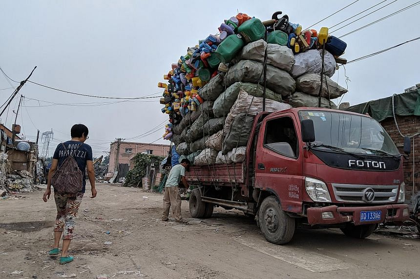 A recycling market in Beijing's Changping district. The local government wants households to sort waste, and state enterprises to handle waste collection and recycling.