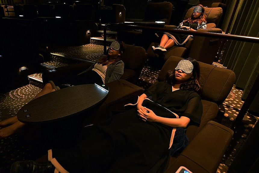 Above: Golden Village in Suntec City charges customers $10 to snooze for 90 minutes in a Gold Class recliner. Left: Fitness chain Virgin Active has five sleep pods in its two flagship outlets available for members to book in blocks of 20 minutes. Yun