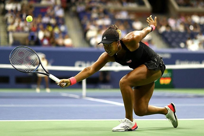 Naomi Osaka stretching for a backhand return to American Madison Keys in the US Open semi-finals on Thursday in New York. The Japanese won 6-2, 6-4 to enter her first Grand Slam final.