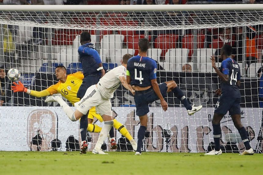 Goalkeeper Alphonse Areola saving during France's Uefa Nations League match against Germany on Thursday night in Munich. He was the key difference between the current and former World Cup holders in the 0-0 draw.