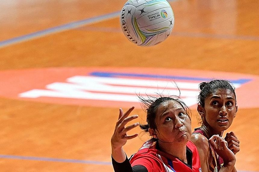 Malaysia goal-shooter An Najwa Azizan, who plays professionally in Australia, in action against Sri Lanka in the Asian Netball Championship. She was injured and limped off at the end of the match.