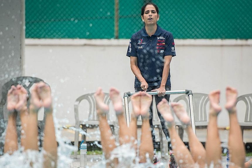 Geraldine Narvaez, the new head coach of the Singapore team, observing the artistic swimmers during the clinic at Toa Payoh Swimming Complex yesterday. In particular, she wants to improve their flexibility and acrobacy.