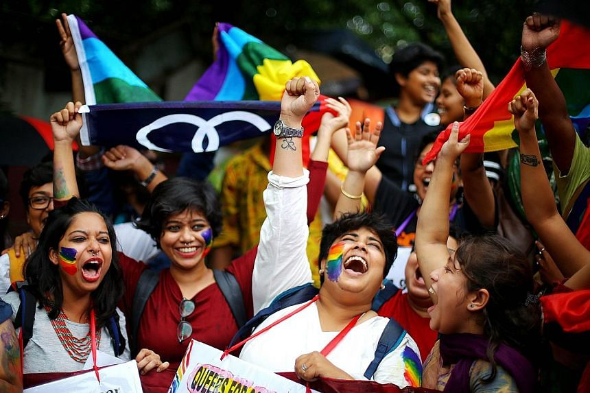 Activists of the Indian lesbian, gay, bisexual, and transgender community celebrating the Indian Supreme Court verdict at a rally in Kolkata, in eastern India, on Thursday.