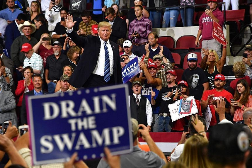 """US President Donald Trump at a rally in Billings, Montana, on Thursday. He questioned whether the anonymous op-ed was an act of treason, and called it """"a threat to democracy itself""""."""