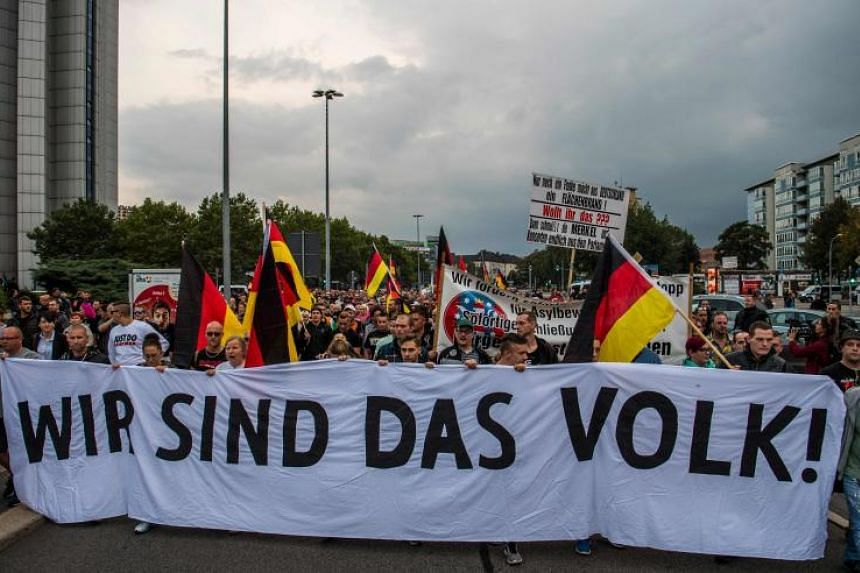 """Members of the right-wing populist """"Pro Chemnitz"""" movement march through the streets of Chemnitz, Germany, on Sept 7, 2018."""
