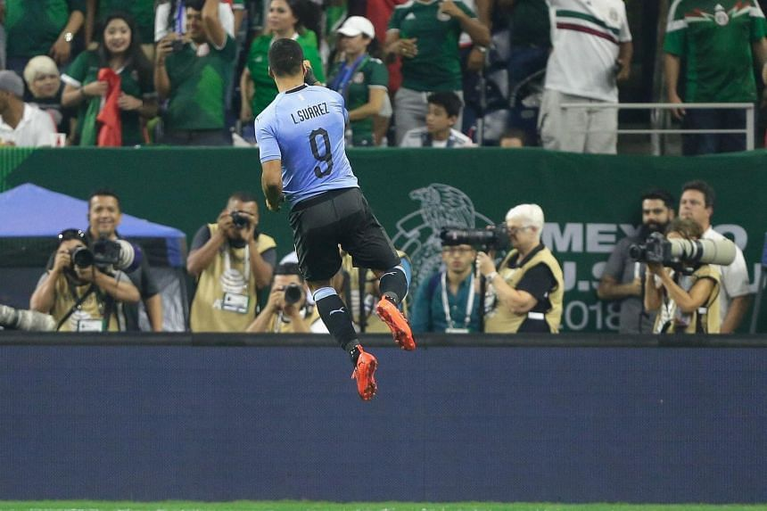 Uraguay's Luis Suarez celebrates after scoring against Mexico during the International Friendly match between Mexico and Uruguay in Houston, on Sept 7, 2018.
