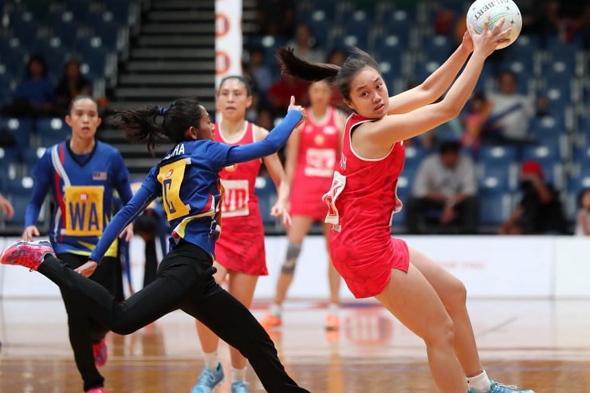 Singapore's Toh Kai Wei in action during the Asian Netball Championship semi-finals match against Malaysia at at the OCBC Arena on Sept 8, 2018.