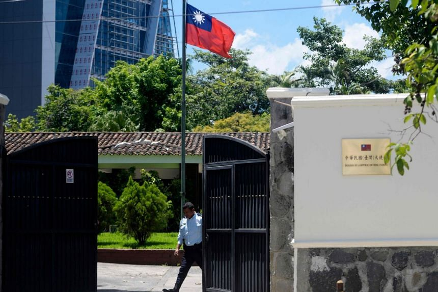 A guard closes the gate of the Embassy of Taiwan in San Salvador, on Aug 21, 2018.