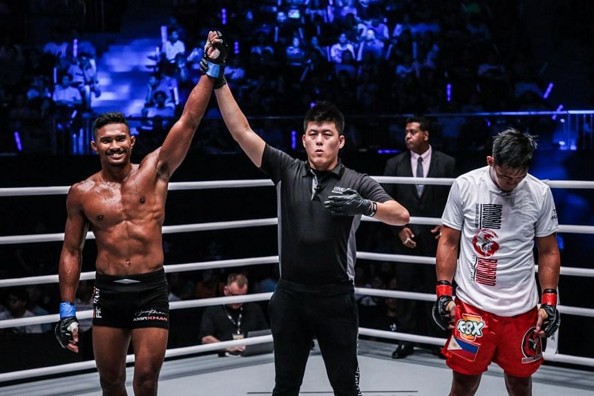"Singapore lightweight contender Amir Khan (left) after his victory over former ONE Featherweight World Champion Honorio ""The Rock"" Banario of the Philippines, Sept 8, 2018."
