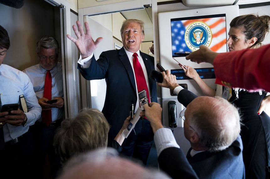 Trump talks to reporters aboard Air Force One while headed to North Dakota, Sept 7, 2018.