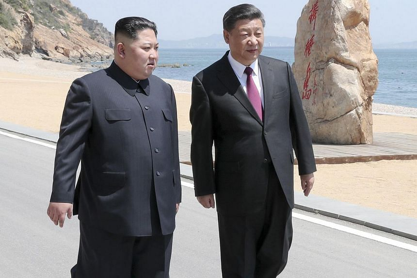 North Korean leader Kim Jong Un (left) and Chinese President Xi Jinping have met three times this year as the two countries sought to repair relations frayed by North Korea's nuclear activities.