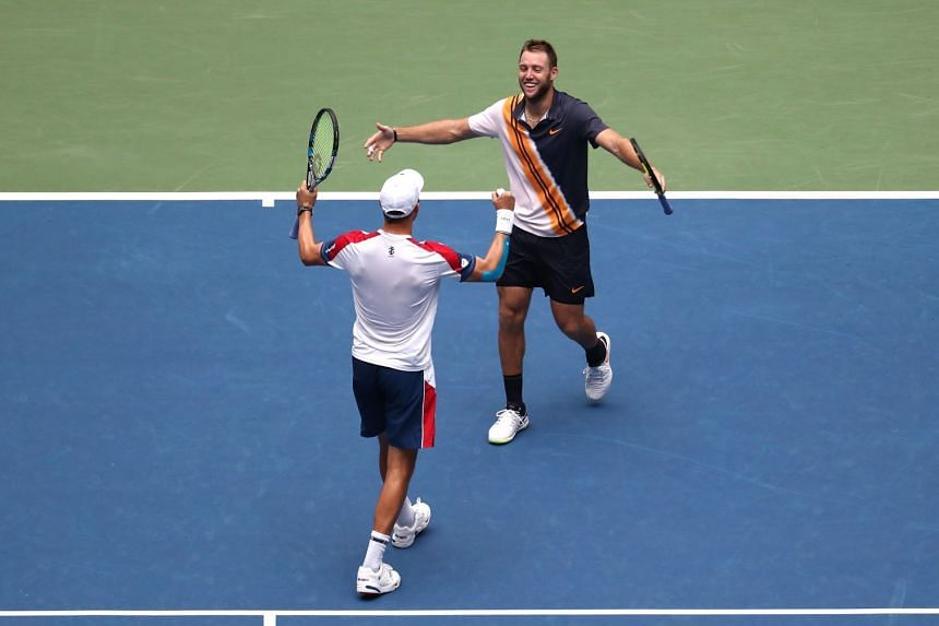 Jack Sock and Mike Bryan of the US celebrate match point.