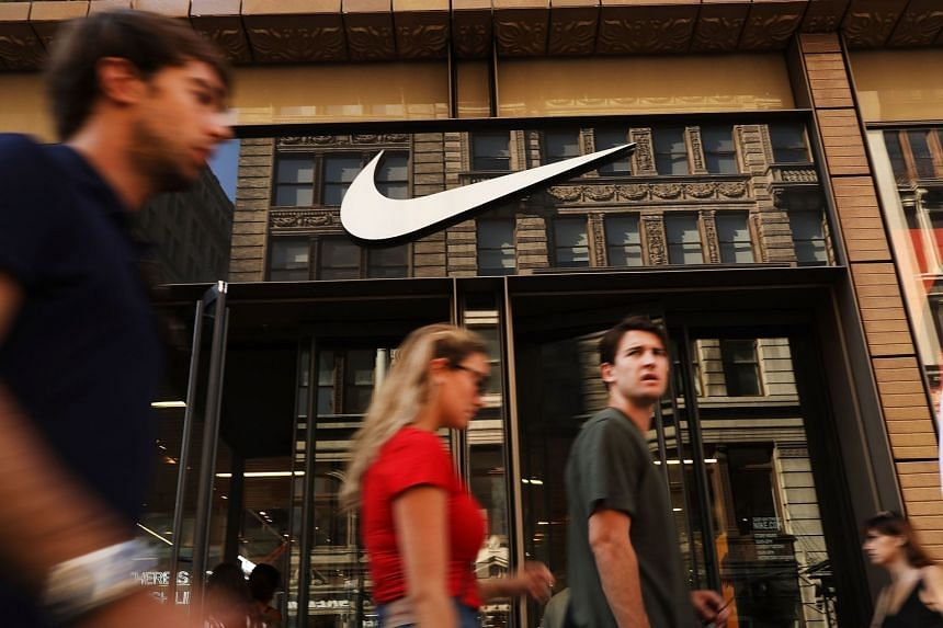 People walking by a Nike store in Manhattan on Sept 5, 2018 in New York.