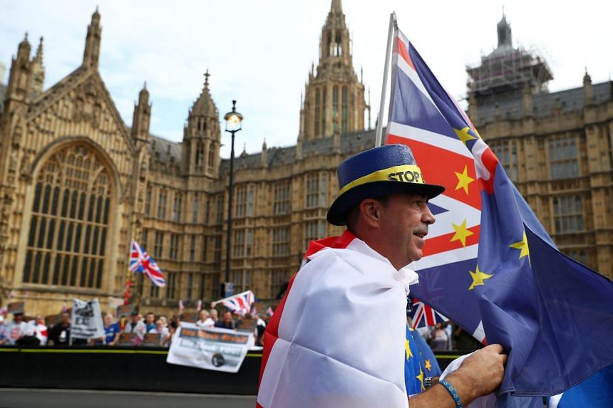 Pro- and anti-Brexit protesters demonstrate outside the Houses of Parliament in London, Sept 5, 2018.