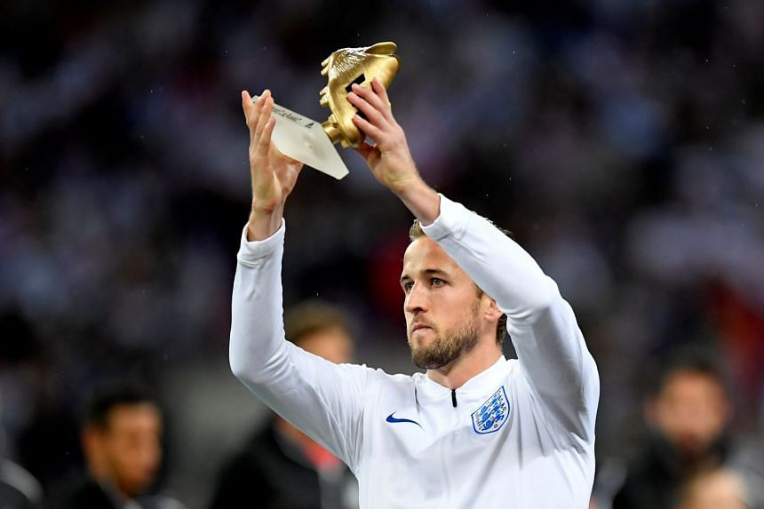 England's Harry Kane holds up the World Cup Golden Boot.