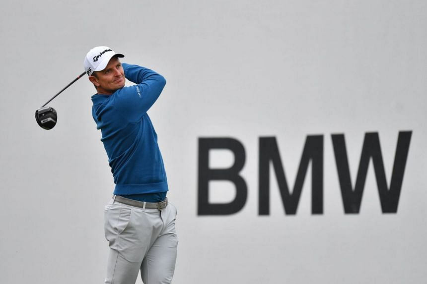 Britain's Justin Rose hits his tee shot on the 18th hole during the third round of the BMW Championship golf tournament at Aronimink.