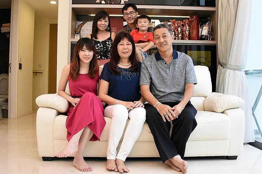 Mr Victor Lim, 60, with his wife Stella Leong, 60, and daughter Dina, 30, on the sofa. Behind him are his son Winchester, 34, daughter-in-law Joanne Teng, 34, and grandson Xavier, five. Mr Lim bought the three-storey, 3,500 sq ft penthouse at Skies Milton