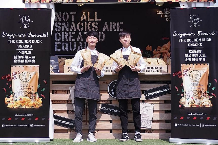 Made-in-Singapore salted egg yolk snacks, such as those offered by The Golden Duck, are a big hit in Hong Kong.