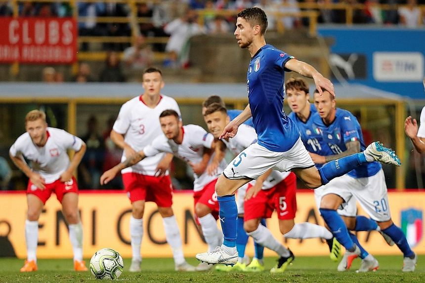 Italy's Jorginho converting a penalty as he makes amends for his blunder which led to Poland's goal in the 1-1 Nations League draw on Friday.