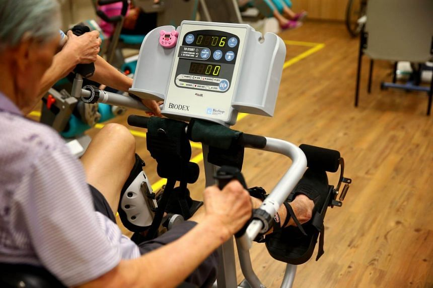 A senior citizen working out on an exercise machine.