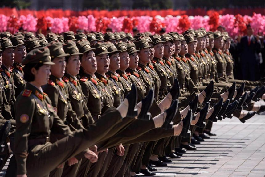 Korean People's Army soldiers march during a mass rally on Kim Il Sung square in Pyongyang, on Sept 9, 2018.