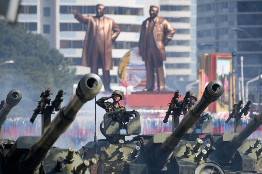 Korean People's Army soldiers salute as they ride tanks during a military parade and mass rally on Kim Il Sung square in Pyongyang, on Sept 9, 2018.
