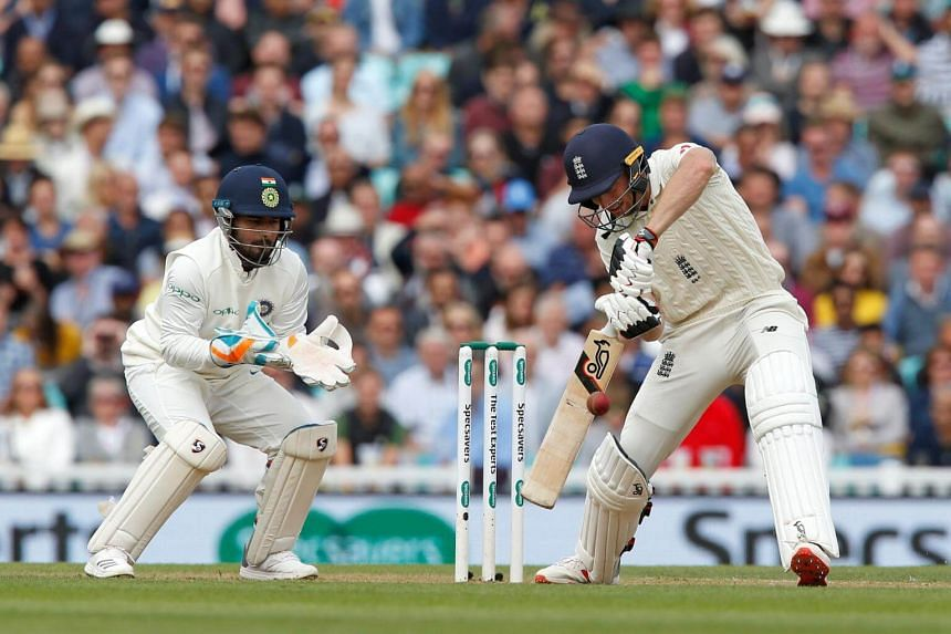England's Jos Buttler (right) plays a shot during play on the second day of the fifth Test cricket match between England and India at The Oval in London, on Sept 8, 2018.