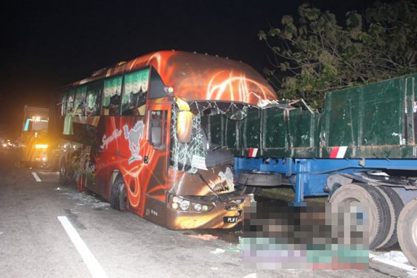 The bus was travelling from Kuala Lumpur to Singapore when the accident happened at about 1.30am on the North-South Expressway.