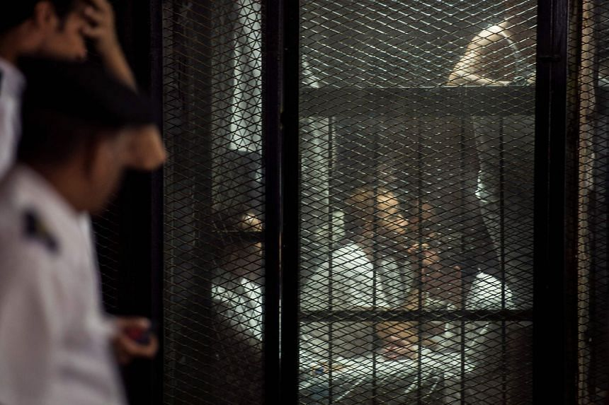 Detainees inside the soundproof glass dock at the hearing on Sept 8, 2018.