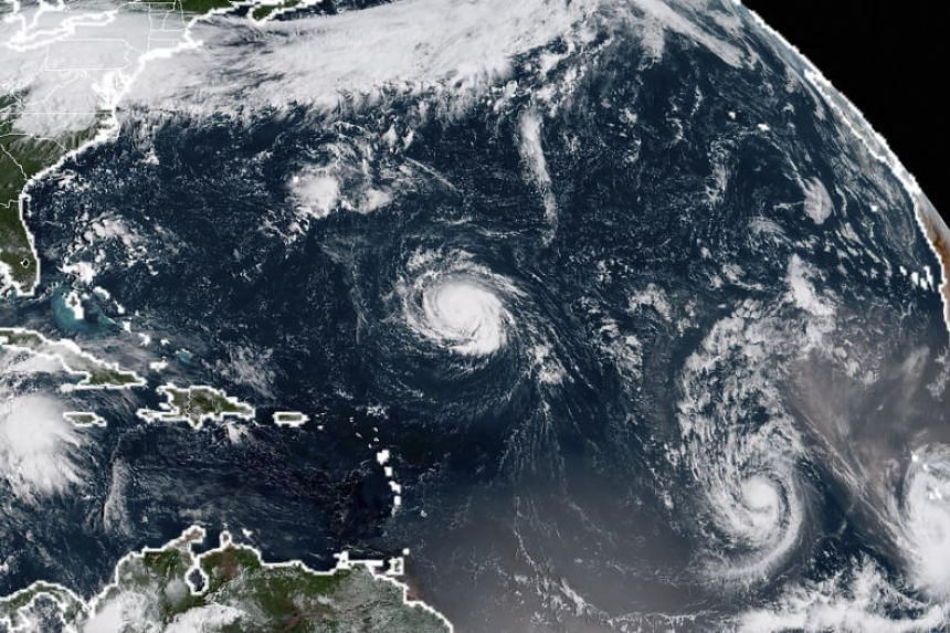 A satellite image taken on Sept 9, 2018, shows (from left) Tropical Storm Florence, Tropical Storm Isaac and Tropical Storm Helene in the Atantic Ocean.