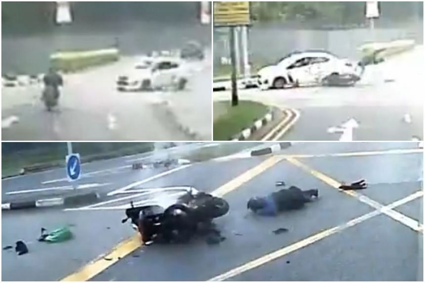 A white car turns right and cuts into the path of a motorcyclist, who is sent flying by the impact of the crash.