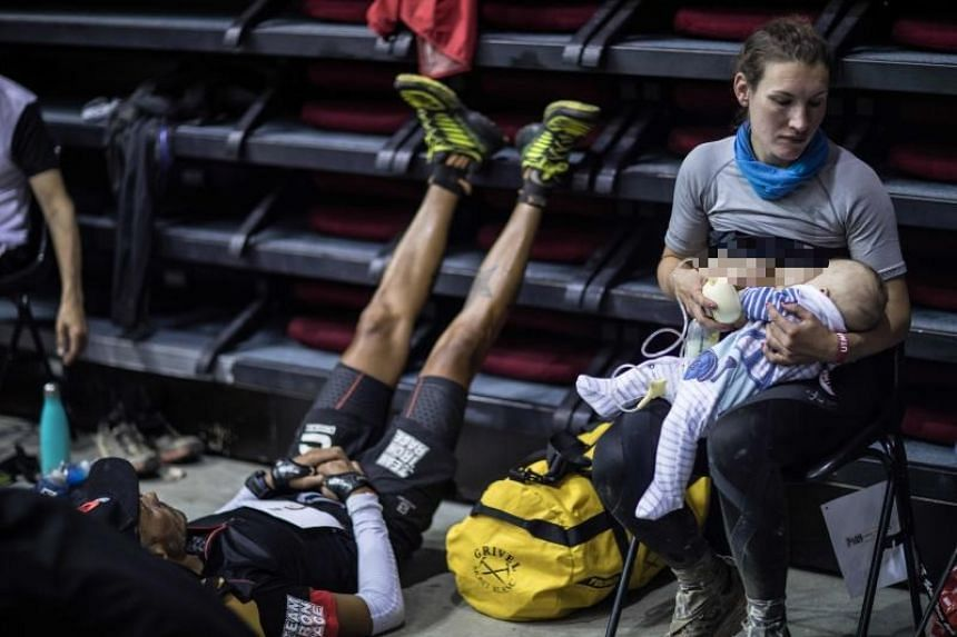 British trail runner Sophie Power breastfeeding her three-month-old baby Cormac during a break as she competes in the 170km Mount Blanc Ultra Trail race on Aug 31, 2018.