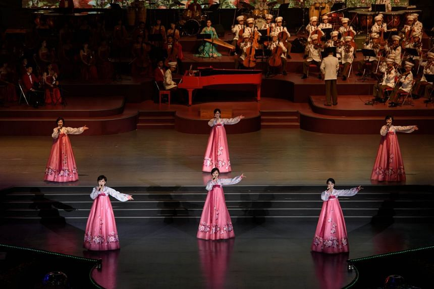 Performers take part in a concert at the Pyongyang Indoor Stadium on Sept 8, 2018.