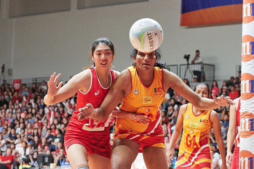 Singapore's GK Chen Lili and Sri Lanka's GS Tharjini Sivalingam jostle for a loose ball during the final, which Sri Lanka won 69-50.