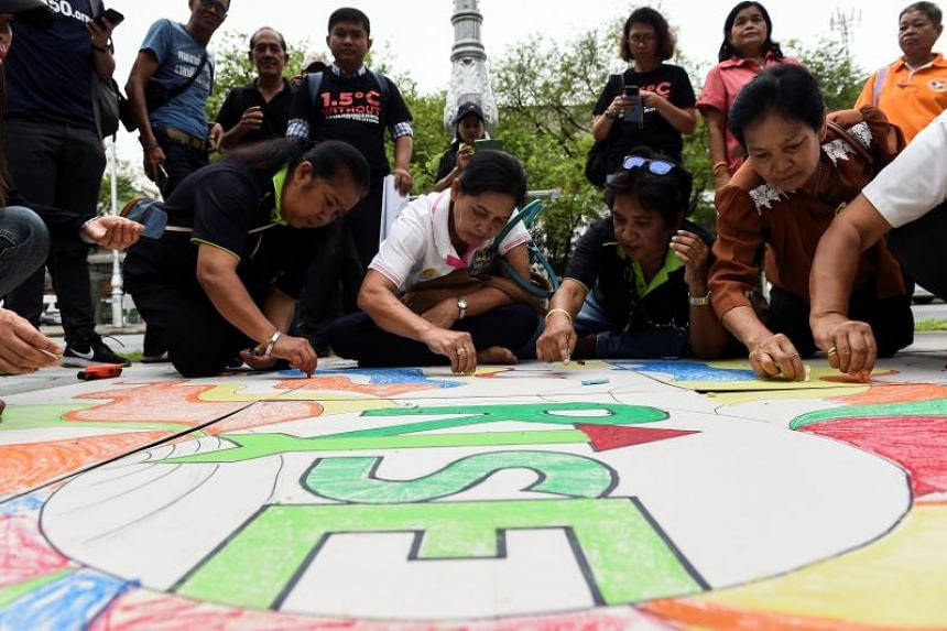Environmental activists and supporters in a demonstration in front of the United Nations building, where experts engage in key talks about climate change, in Bangkok on Sept 8, 2018.