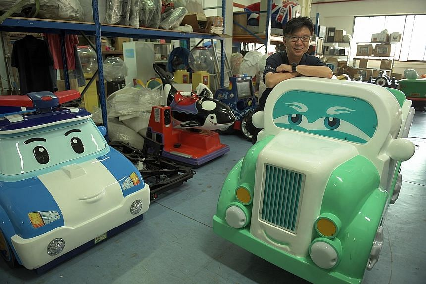 Mr Robert Chew, who has a team of nine deaf technicians, supplies and maintains more than 200 kiddy rides in Singapore.