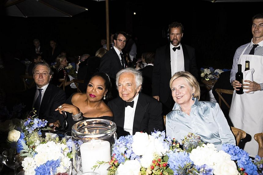 """The real reason """"we're all here is not because of the show, but because of you"""", said media executive Oprah Winfrey (second from left) at Ralph Lauren's show at New York Fashion Week. The event, which marked the 50th year in the industry for the icon"""