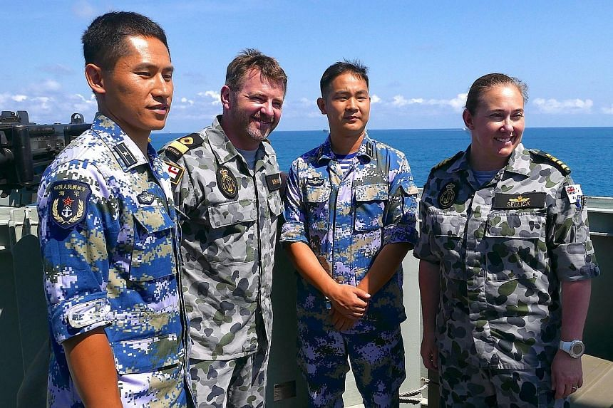 Royal Australian Navy officers with their Chinese counterparts during Exercise Kakadu off Darwin. This is the first time that China is taking part.