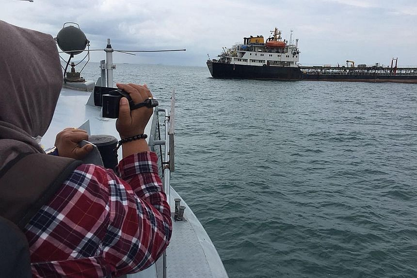 MV Eastern Glory in waters off Batam. The vessel was intercepted last Wednesday. The Indonesian captain and his crew are being detained for investigation and are facing charges as stipulated under Indonesian laws that cover trade of oil and gas, and