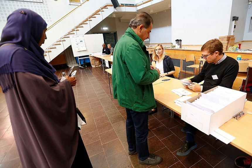 People arriving at a polling station in the Rinkeby neighbourhood in Stockholm. In Sweden, the influx of 163,000 asylum seekers in 2015 has polarised voters, fracturing the political consensus, and could give the Sweden Democrats a veto over who form