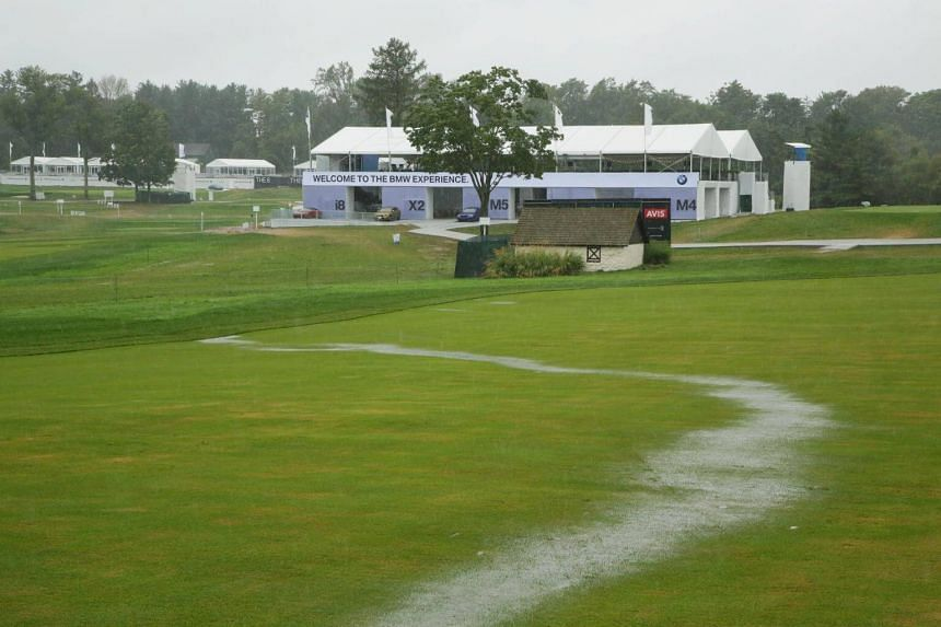 A stream of rain water runs down the 18th fairway during a weather delay prior to the final round of the BMW Championship at Aronimink Golf Club on Sept 9, 2018 in Newtown Square, Pennsylvania.
